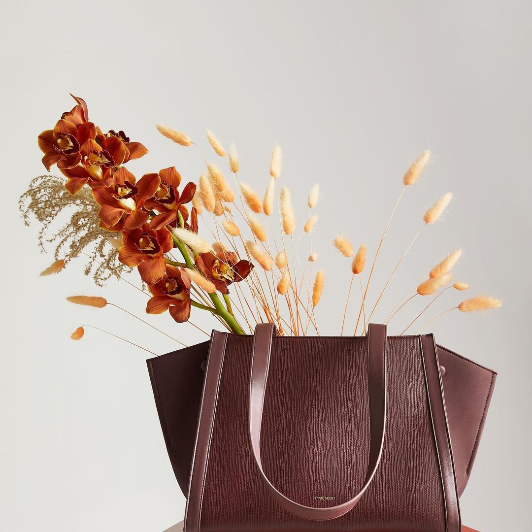 Dark coloured bag with dried florals