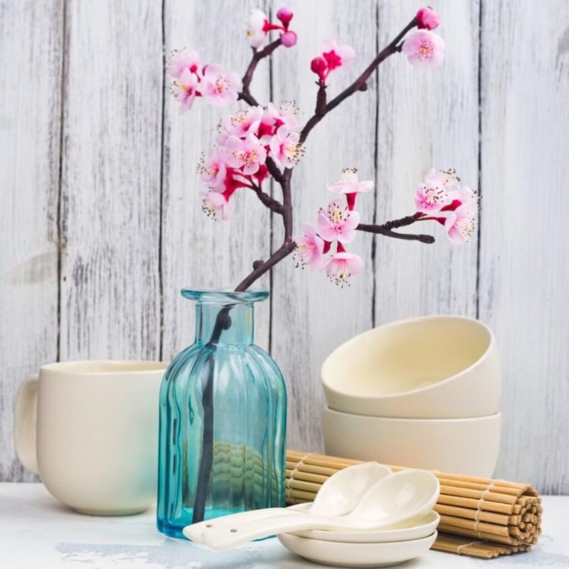 Blue vase with cherry blossom branch