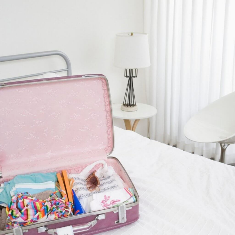 Packed suitcase in bedroom