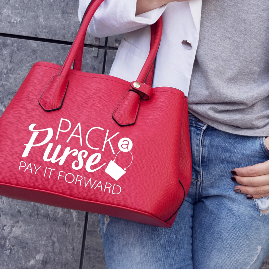 Woman holding a red Pack a Purse bag
