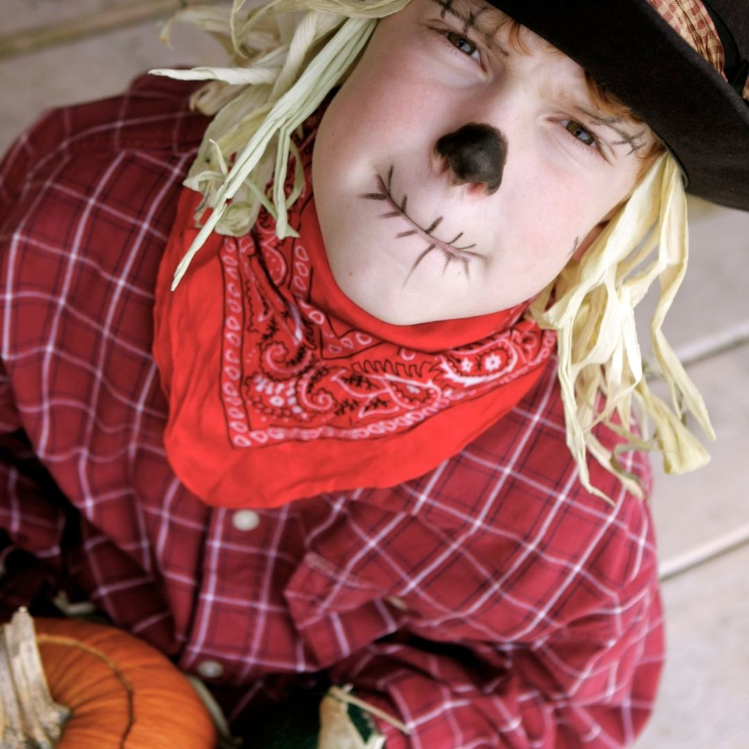 Kid dressed up as a scarecrow