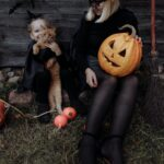 Woman and a little girl in Halloween costumes